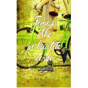 Femeie alba pe bicicleta verde