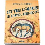 Cei trei magarusi si cartea fermecata de Gabriel H. Decuble